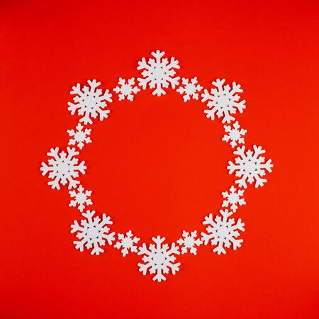 Snowflakes on a bright red background. We are preparing to meet the new year 2020 and Christmas. 版權商用圖片