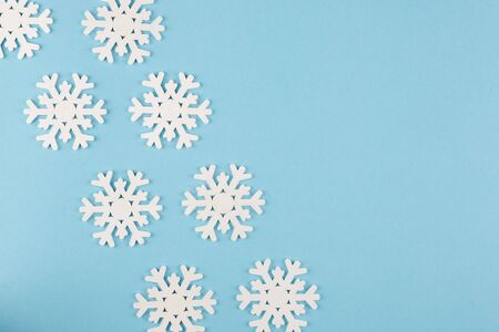 Holiday Christmas background. Decorated with snowflakes on a blue background. Stok Fotoğraf