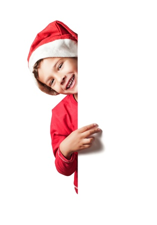 Child as Santa Claus holding a white blank sign Stock Photo