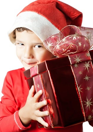 Child as Santa Claus smiling and holding a gift