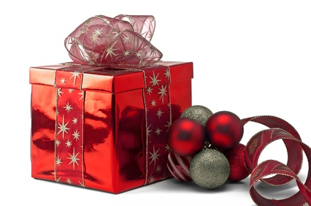 A red gift box with Christmas decorations