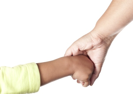 Mother and child hold by hands on a white background