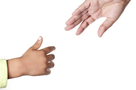 A child try to reach is mother hand on white background  Stock Photo