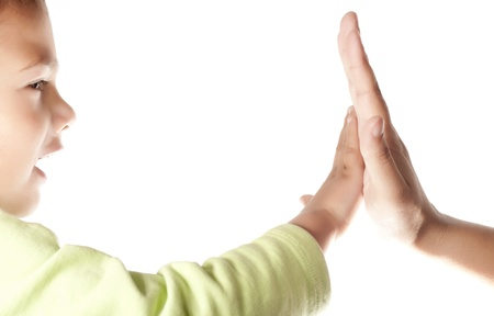 Child and  mother giving a High Five on white background