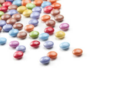 Groung of colorfull candys over a white background