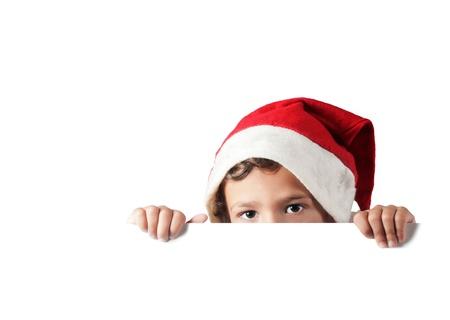 child peeking behind a white blank sign Stock Photo