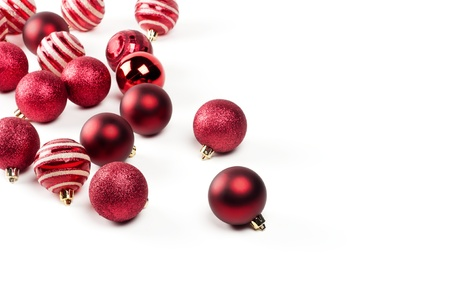 Christmas baubles over a white background