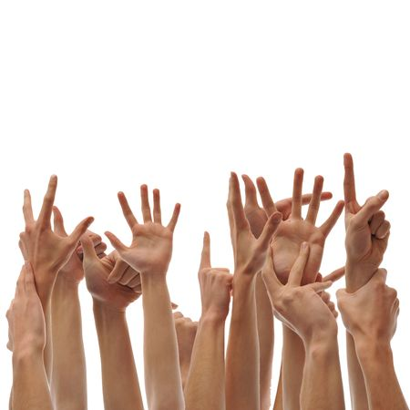 grabbing hand: A bunch of raised hands. Questions, votes, and volunteers. Stock Photo