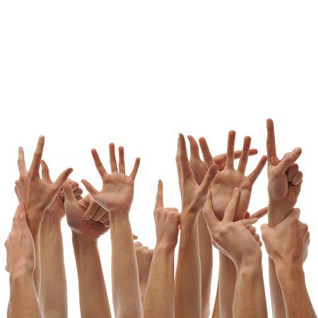 Een stelletje verhoogde handen. Vragen stemmingen en vrijwilligers. Stockfoto