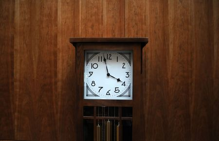 grandfather clock: Modern clean grandfather clock against wooden wall