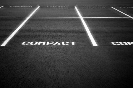 Compacte parkeer terrein met een lichte zoom effect toegepast in-en uitzoomen naar het woord cd.