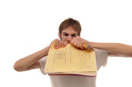 provoked: Angry young man ripping trying to papers on white background.
