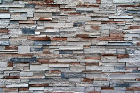 A great texture of a wall with various sized bricks. Mainly white, red, and blue. Stock Photo - 6045213