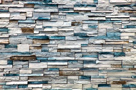 A stone wall with mainly white and blue bricks, but some few are brown. Stock Photo - 6045406