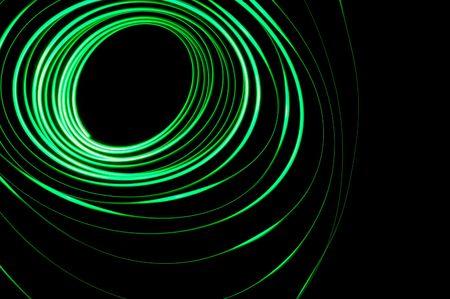 pendulum: A glowing green physiogram on a black background Stock Photo