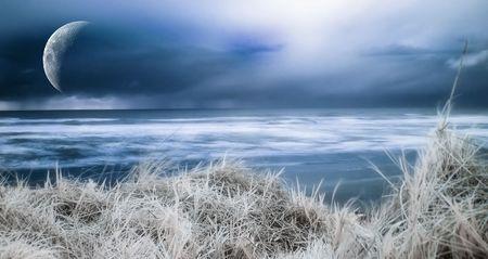 A dreamy photograph of a blue ocean shore.