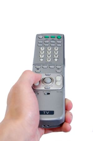 A hand holding the TV controller.