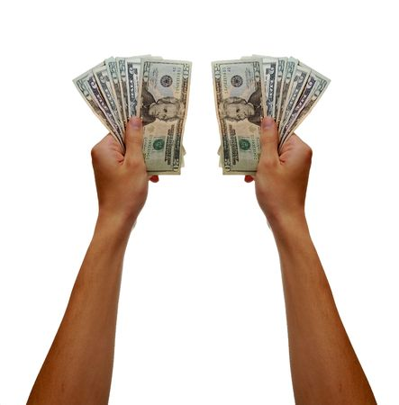 A hand holding a bunch of american 5's and 20's Stock Photo - 6042737