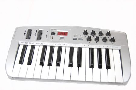 midi: A mini midi keyboard controller isolated on white