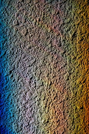 A rainbow reflected on a wall from a window
