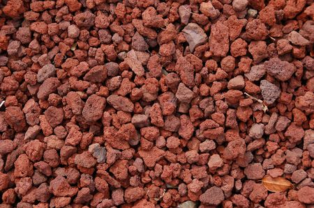 volcanic: A bunch of small red volcanic lava rocks.