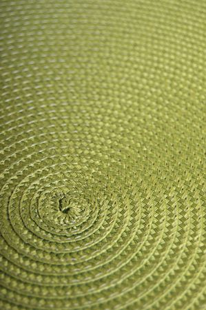 placemat: Circular place mat background. Close up of a dinner placemat.