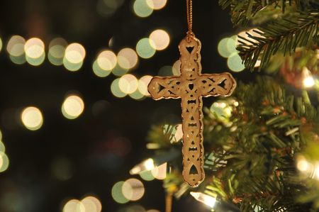 Cross ornament on Christmas tree with bokeh. Taken with a remote to reduce blur at ISO 200.