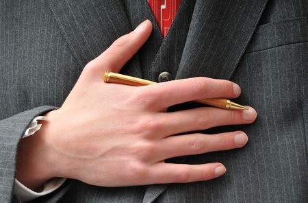 sumptuous: Closeup of a Businessmans gold wooden expensive pen Stock Photo