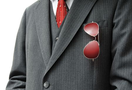 aviators: Pair of Red Aviators in Businessmans Pocket with possible white copy space on the left side.