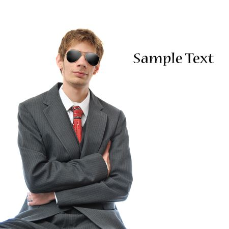 Young Confident Businessman with arms folded, isolated on white background with copyspace. photo