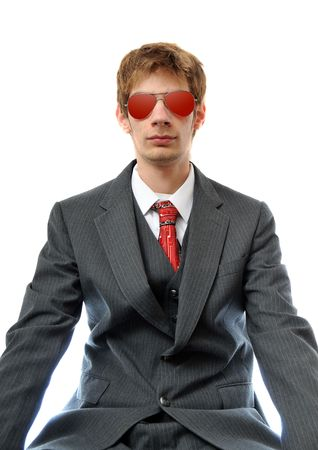 Direct young business man in suit with red aviator sunglasses. photo
