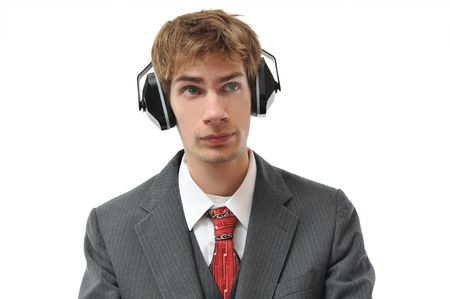 Earmuffs on young businessman for sound protection in the workplace. isolated on white background