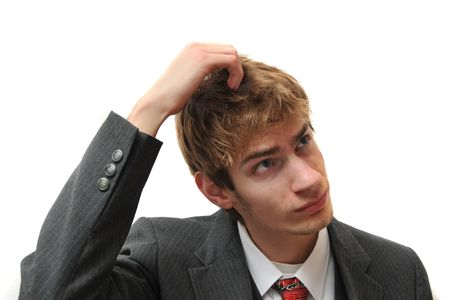 A young white male Caucasian adult in business suit scratching head like a monkey isolated on white photo