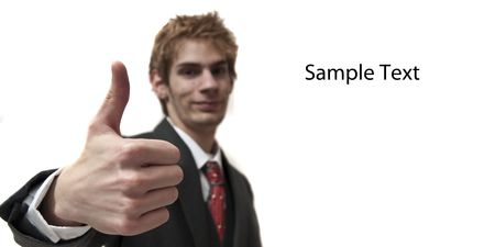 Man with thumbs up in suit with sample text isolated on white background photo