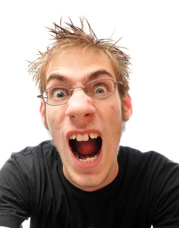 crazed: A young man screams, shouts, and yells in frustration, isolated on white.