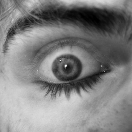 unease: This is a long exposure of an eye open and closed at the same time. You can see the eyelashes at the top and bottom of the eye.