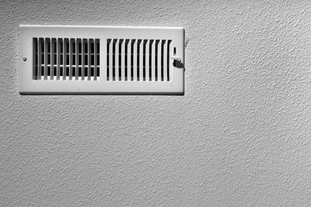 air: Black and white photograph of a ceiling vent background.