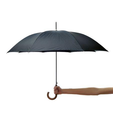 lluvia paraguas: Una mano de largo brazo sostiene un paraguas negro aislado en un fondo blanco  Foto de archivo