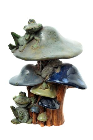 Clay art sculpture of frogs resting on tall mushrooms isolated on white background