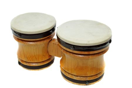 Two pair of miniature toy bongo drums isolated on white background. photo