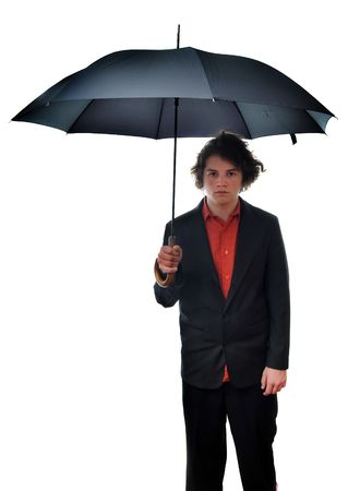 A young businessman holds his umbrella with a blank, annoyed look on his face. Isolated on white background. photo