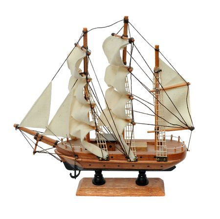 Miniature wooden model of a sail ship isolated on white background photo