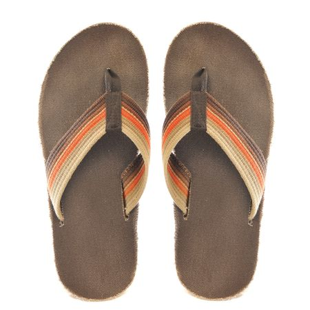 flops: Pair of brown and orange retro oldschool junglist sandals isolated on a pure white background