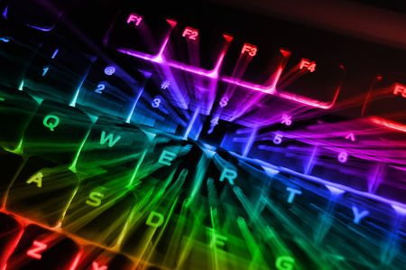 An abstract closeup of a rainbow colored backlit illuminated glowing computer keyboard terminal console.