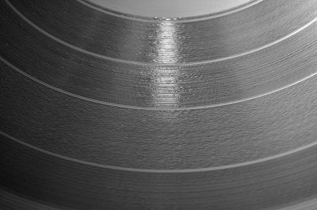 lp: Close up of a 12 inch vinyl music LP record disc.