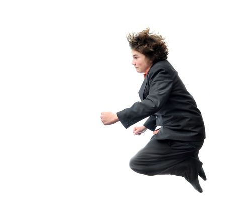flying man: A Young Businessman flying in mid air isolated on white background. Stock Photo