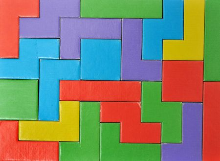 Abstract Colorful puzzle pieces put together. this makes a good  background. This toy is made out of cardboard and this image is a photograph. photo