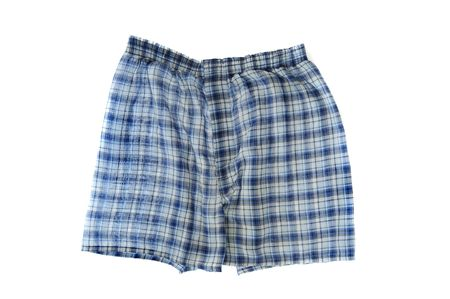 undergarment: A pair of blue plaid boxer shorts isolated on white background. Wrinkled boxers. Stock Photo