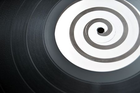 Round circular vinyl lp music record with a spiral design in the middle