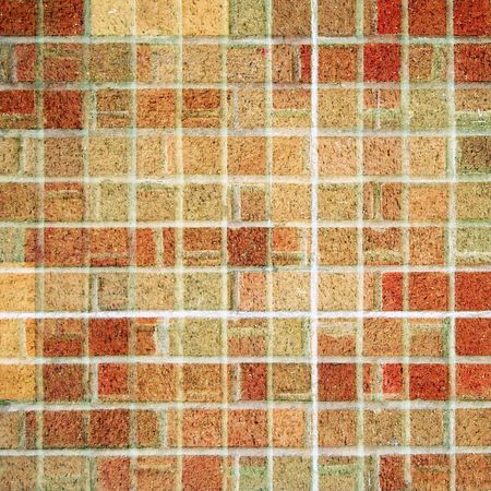 tile flooring: A square brick tile background made from red, brown, and tan square bricks. Stock Photo
